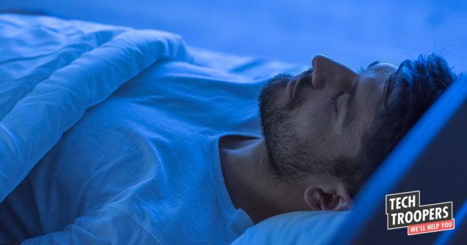 Man sleeping blue light faded