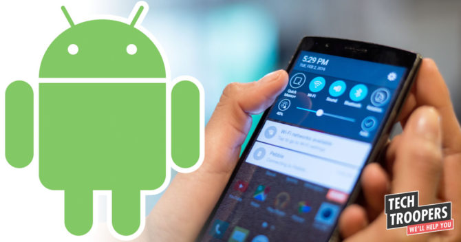 Android icon and hand holding a smartphone
